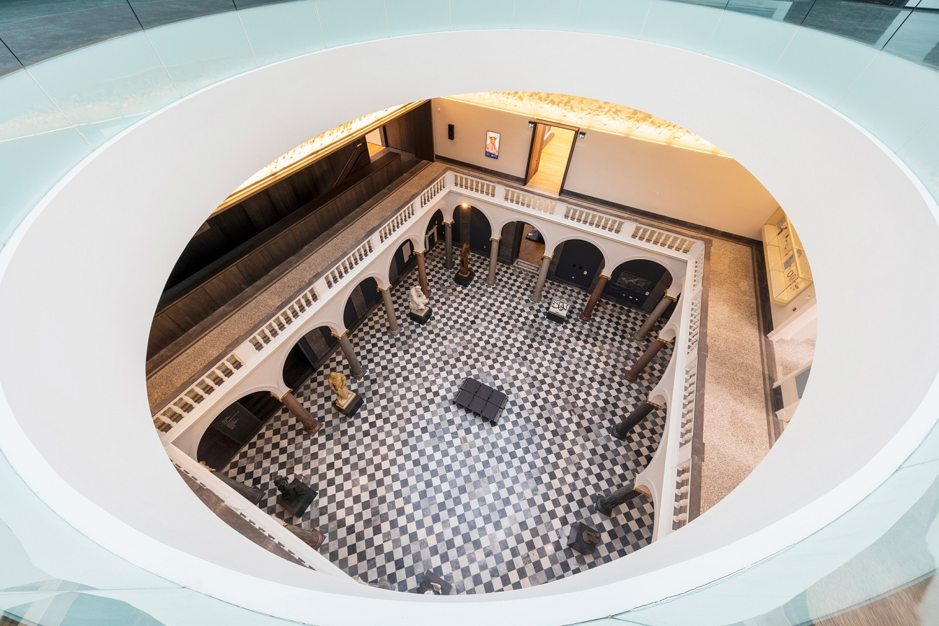 View looking down from the new modern top floor down to the marble hall