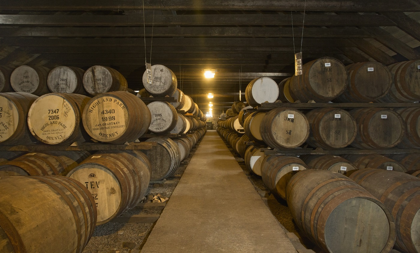 Image of whisky barrels stored in a cellar