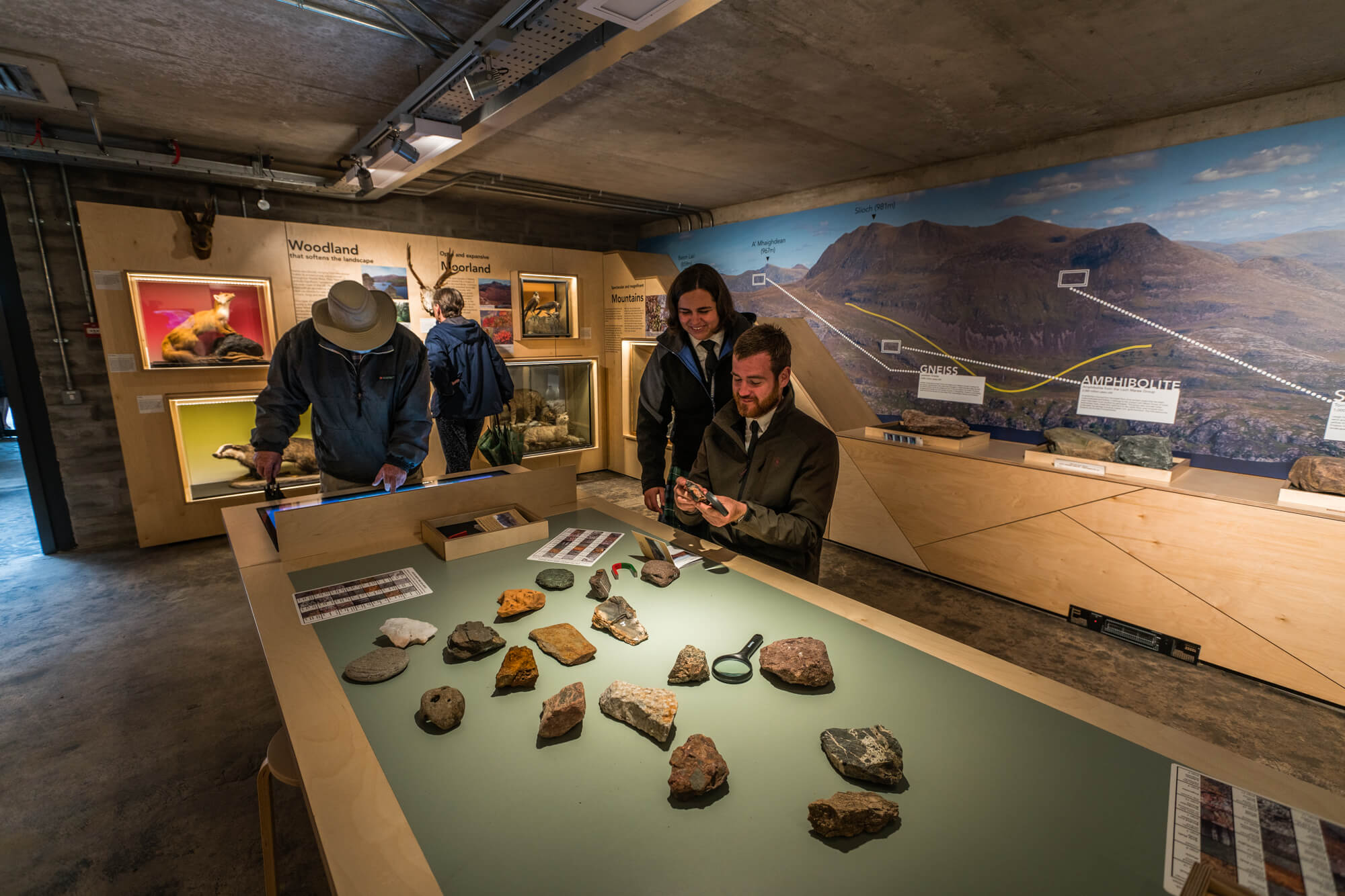 Visitors looking at rock exhibit