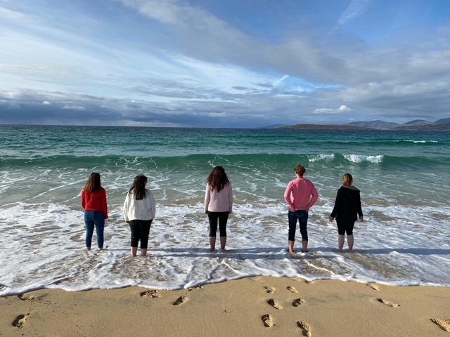 Group of friends on a beach in the Outer Hebrides